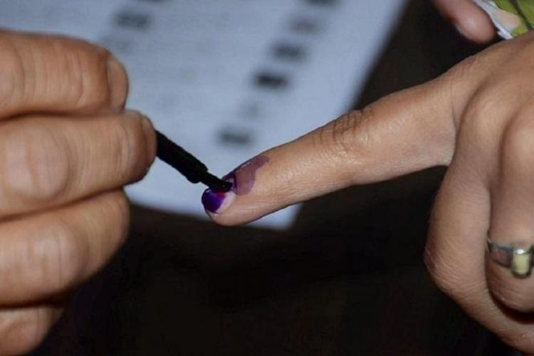 A person getting their finger inked during elections