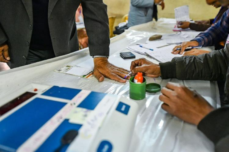 Representative image of ink being marked on a voters finger at an election booth