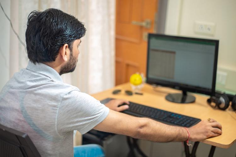 Man in front of a desktop