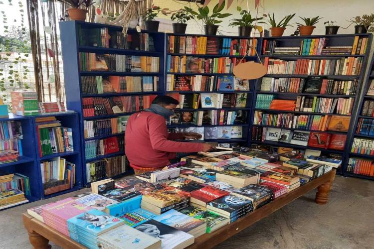 A reader at Bengaluru's pop-up store of Walking Book Fairs in Suncity Layout