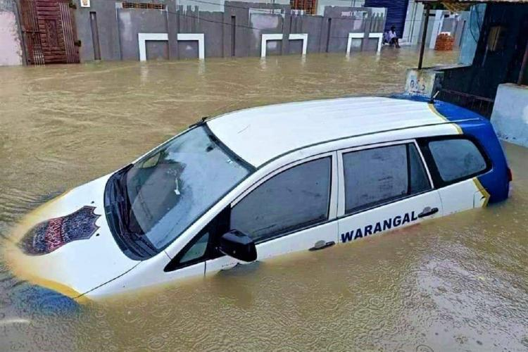 A car of the Warangal police drowns as water flooded parts of the city