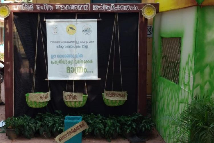 Three baskets hang for three different sorts of waste at a polling booth with a notice paper in between