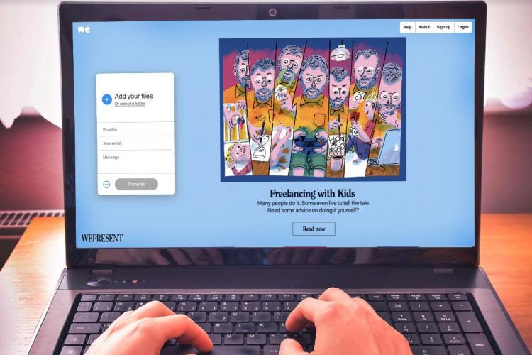 WeTransfer website on a laptop screen