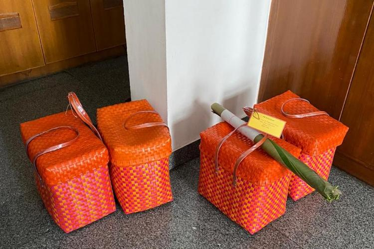 Orange lunch boxes with wedding food packed