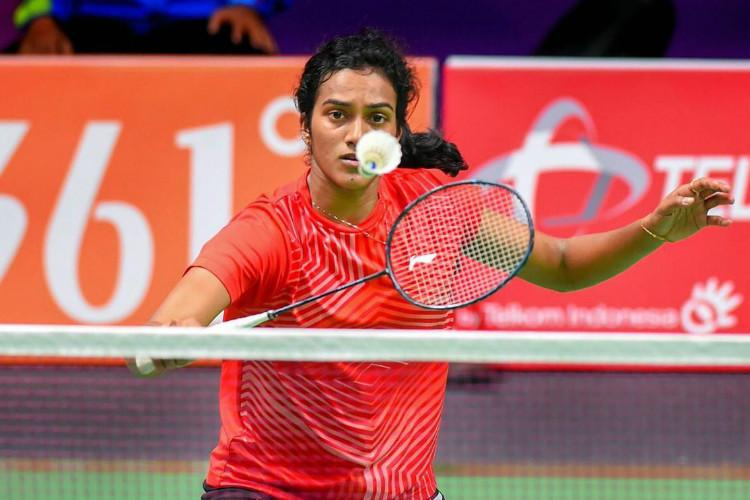 PV Sindhu gives her best in Asiad badminton singles final clinches historic silver
