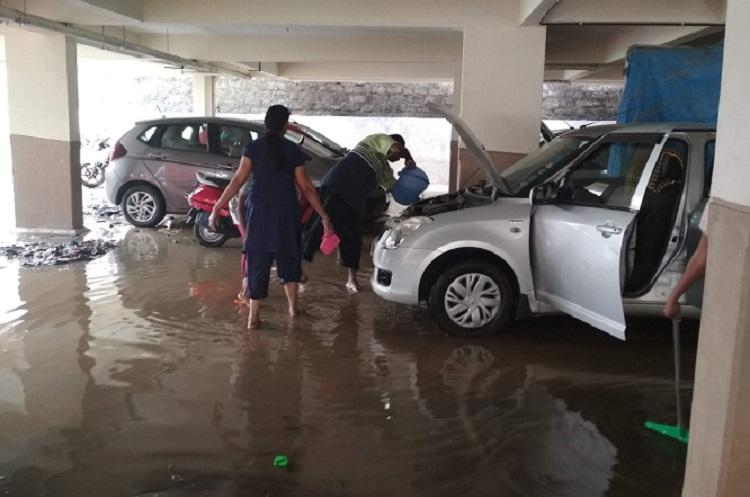 Broken wall damaged cars Heavy rains spell doom for upscale Bengaluru locality
