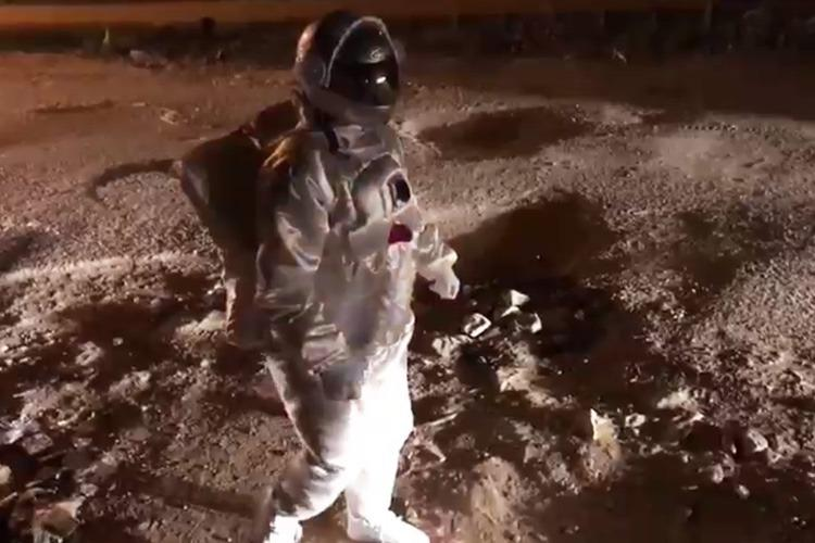 Moonwalk in Bengaluru Crater-sized potholes turns lunar surface for artist
