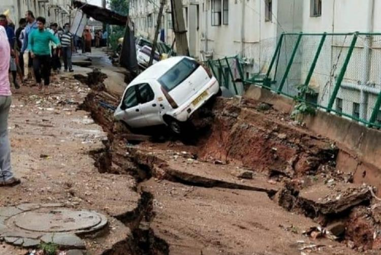 Road caves in due to heavy rains in West Bengaluru 70 families shifted out