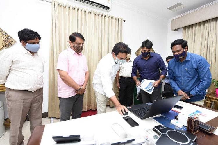 Minister KTR using laptop