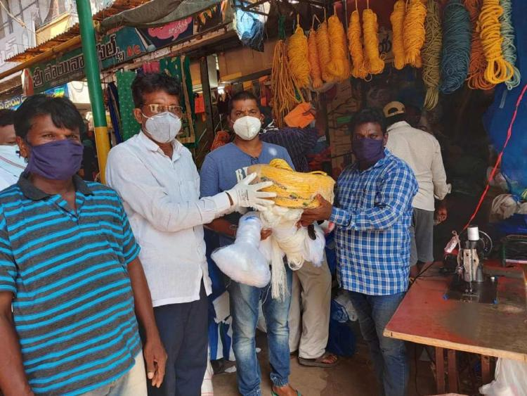 A group of men receiving raw material to make fishing nets from a Donor in Machilipatnam