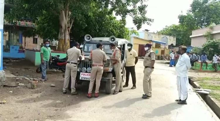 A few policemen and locals were seen standing near a police zeep in a village in Andhra