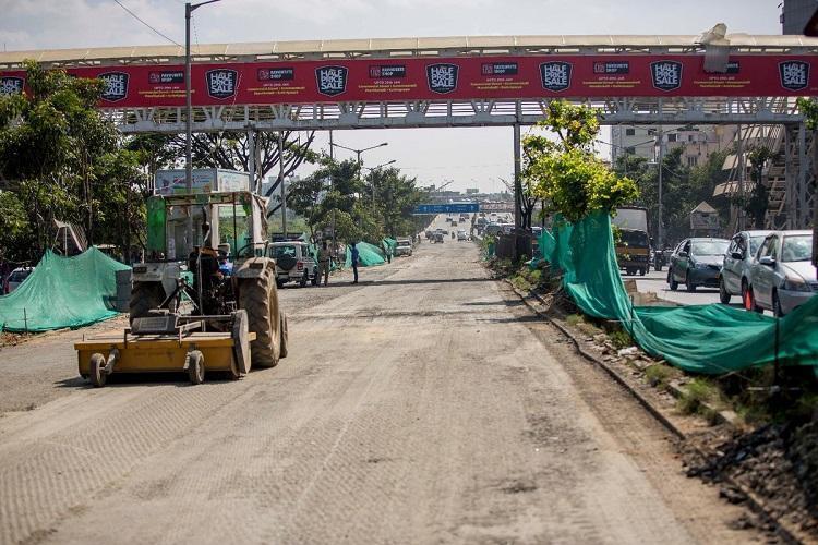 Ktaka CM Yediyurappa orders probe on Bengalurus white-topping Tender Sure works