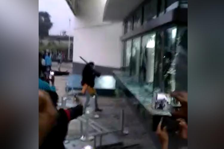 An employee seen holding a rod on the day the Wistron iPhone plant was vandalised