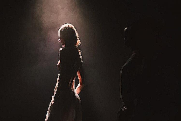 Woman standing under the spot light