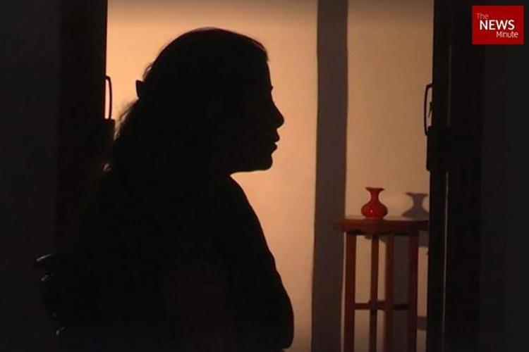 Womans silhouette where she is standing facing towards the right