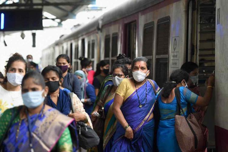 Women passengers deboard a local train at Kurla in Mumbai.