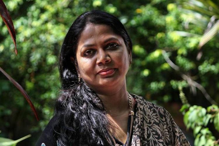 Tamil writer Salma amidst greenery