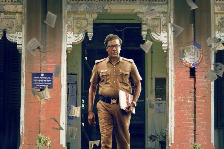 Samuthirakani in police uniform from the film Writer