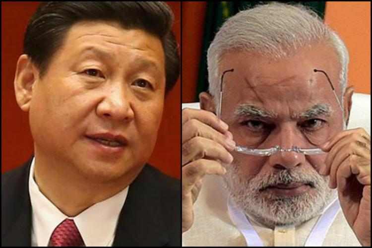 PM Modi looks sternly Xi Jinping in black suit