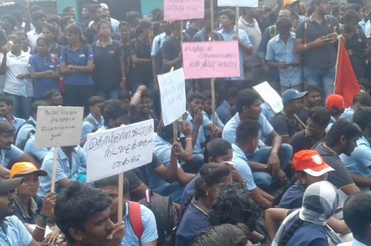 Around 2500 automobile employees take out rally near Chennai Detained by police