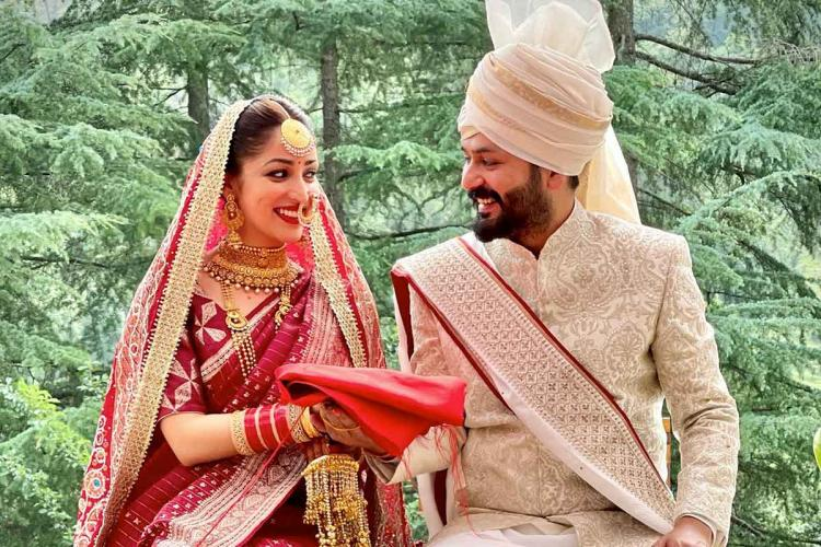 Yami Gautam is in red bridal saree while Aditya is seen in a festive sherwani and turban in an image from the couples wedding
