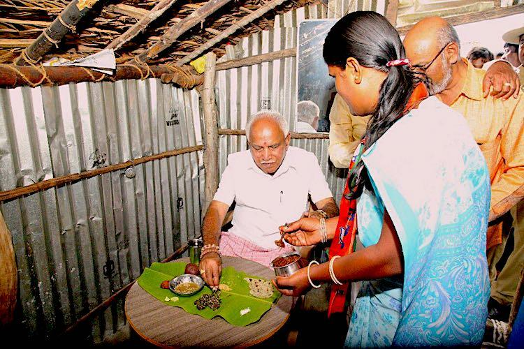 Yeddyurappa learns his lesson This time eats food prepared at Dalit home