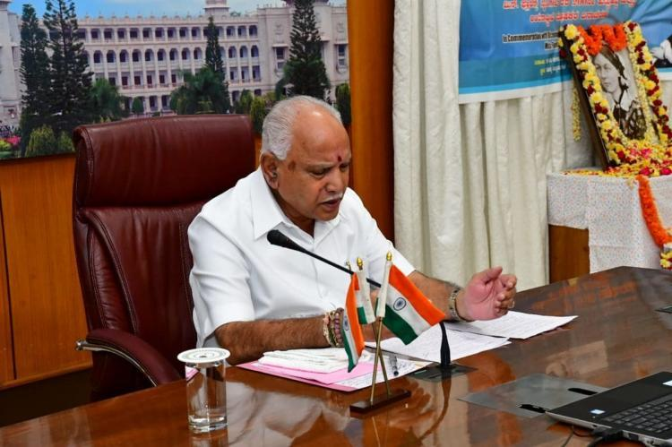 Chief Minister Yediyurappa at his desk before a media briefing