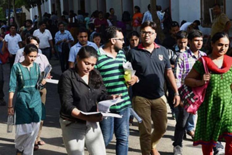 Group of youngsters walking together probably to an exam centre