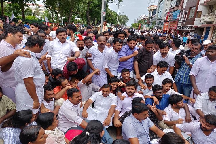 Youth Cong march to Kerala Secretariat turns violent Cops use tear gas stun grenades