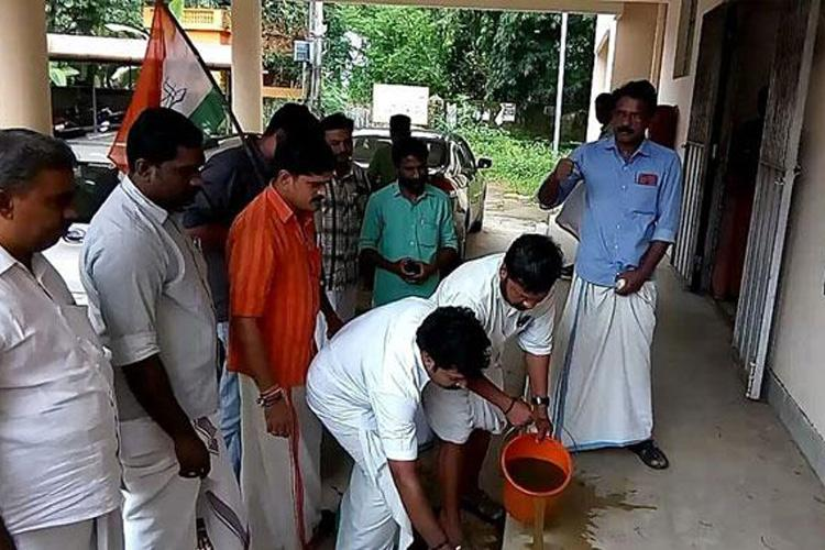 Kerala Youth Cong sprinkles cow dung water to clean venue where Dalit MLA protested
