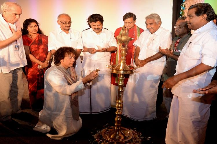 Ustaad Zakir Hussain goes on his knees to light inaugural lamp at IFFK