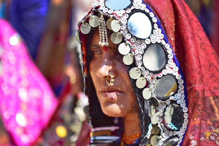 A woman from Lambani community dressed in traditional attire replete with mirror work