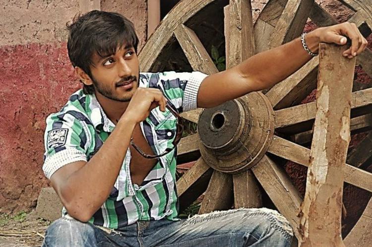 Actor Chetan posing for a shot
