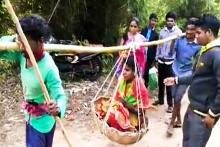 Carried on makeshift stretcher tribal woman in Andhra delivers baby on dirt path