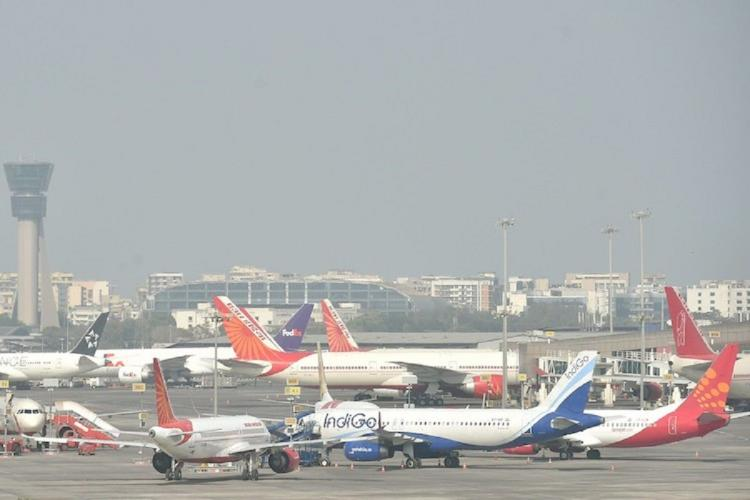 Aeroplanes of multiple airlines on a tarmac