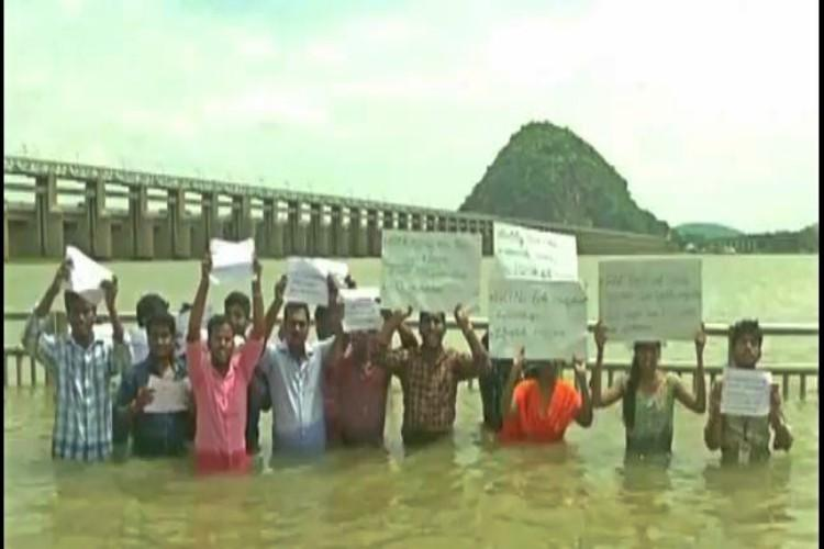 Andhra agri students protest in waist-deep water in Vijayawada demand restoration of GO 64