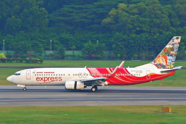 Air India Express flight painted white and red about to take off