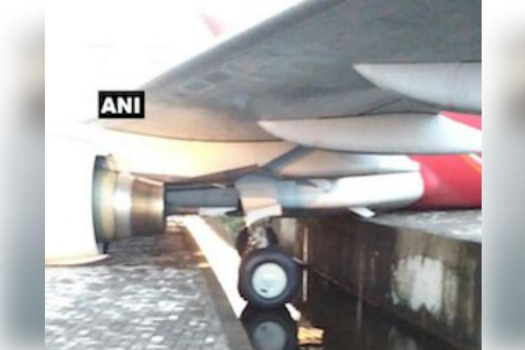 Air India plane rolls into drain at Kochi airport