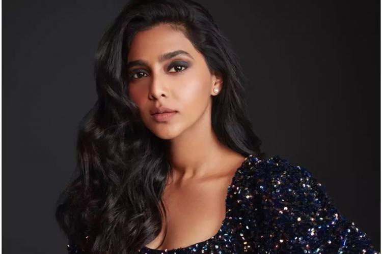 Aishwarya Lekshmi close up in a black glitter dress