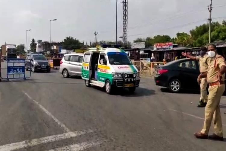 Telangana police personnel stopping an ambulance coming from Andhra