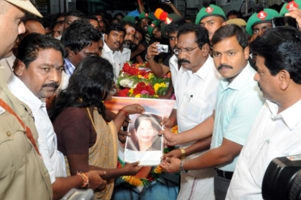 First flood relief now Jayalalithaa photo on wreaths and on cheque for Siachen martyrs family