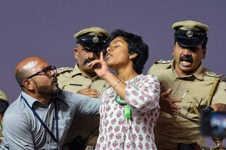 Amulya Leona taken away by officials from anti CAA protest in Bengaluru in February