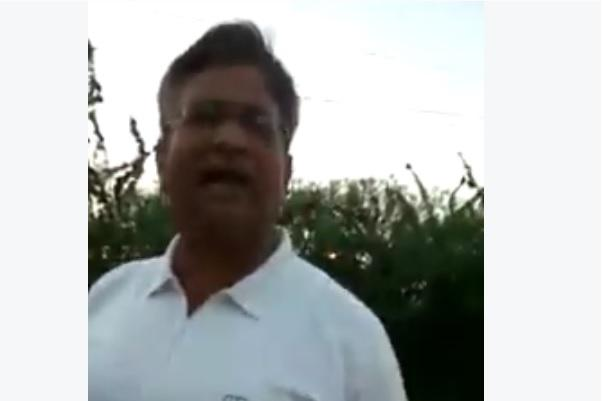 Video Angry Colonel abuses lady for feeding stray dog throws stone at it out of spite