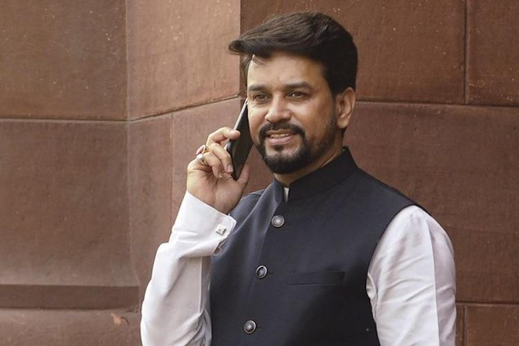 A file photo of Anurag Thakur talking on the phone looking at cameras in Parliament