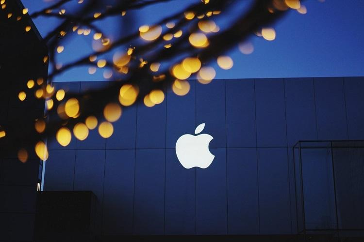Apples white logo on a building with a glass wall