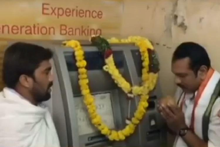 Watch video Congress leader performs puja at ATM