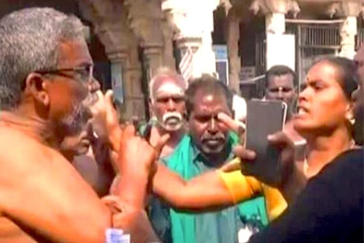 Fraud vs Slut Farmer leader Ayyakannu gets into fist fight with BJP woman