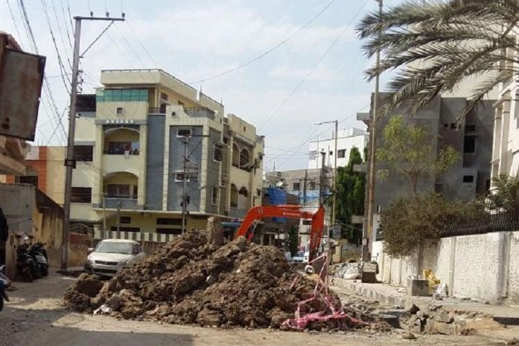 Dug-up roads dust and sewage waste leave Hyderabad residents gasping for fresh air