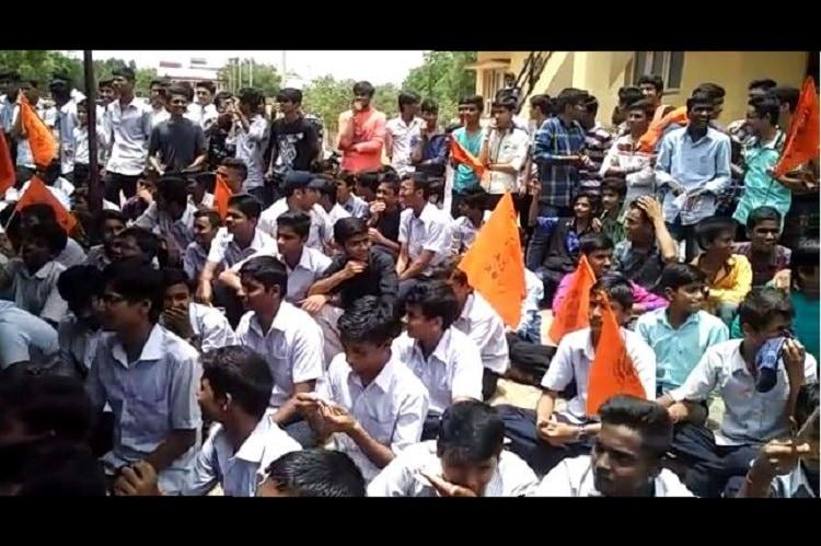 Bagalkote ABVP activists barge into ministers office slipper Karnataka CMs photo