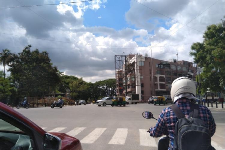 Bengaluru street crossing near MG Road where autos are plying